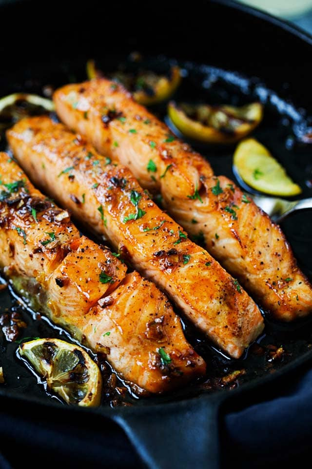 How to cook salmon on the stove? Salmon fillets with honey garlic sauce cooked in a pan.