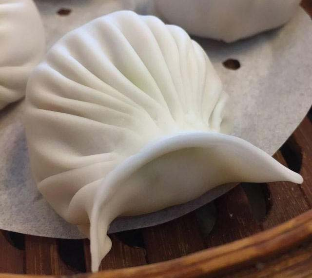How to wrap har gow? A perfectly wrapped har gow shrimp dumpling, before steaming.