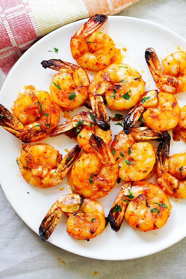 Grilled shrimp on a plate.