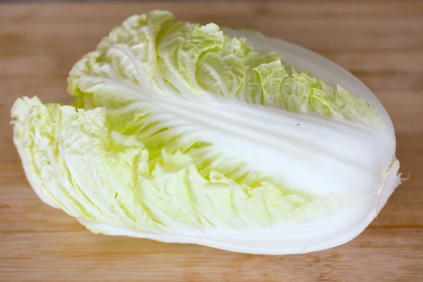 Napa cabbage on a cutting board.