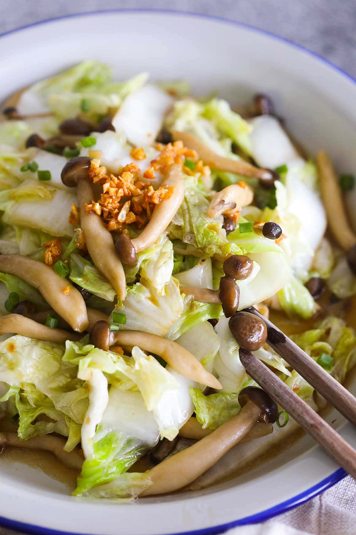 Napa cabbage stir fry with mushroom on a plate.