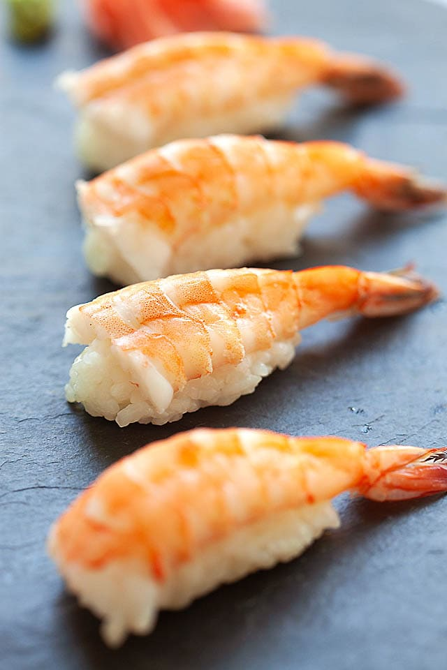 Shrimp nigiri on sushi board.