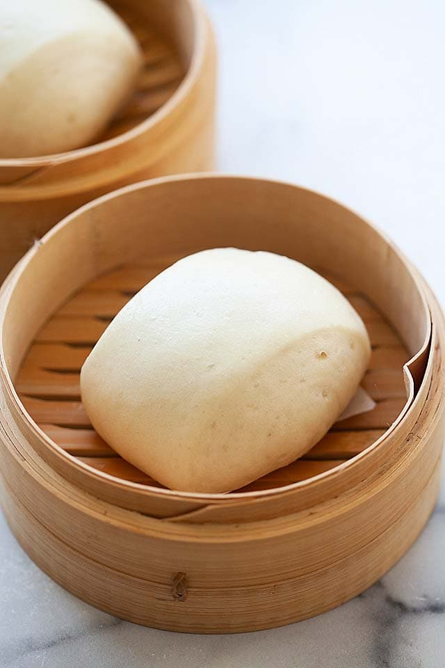 Steamed buns in a bamboo steamer.