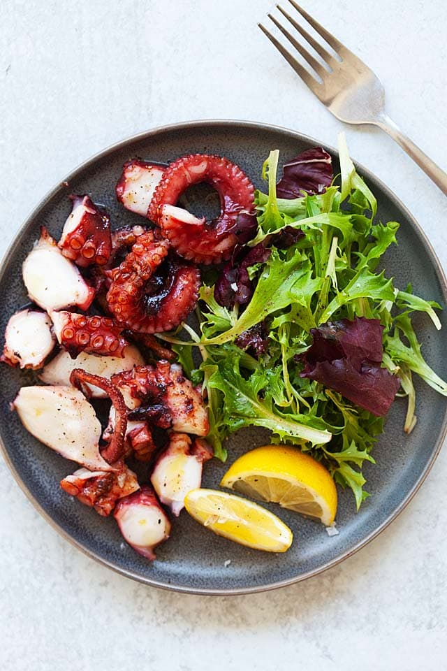 Grilled octopus on a plate.