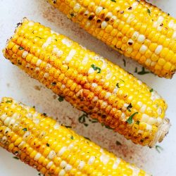 Grilled corn with garlic butter.