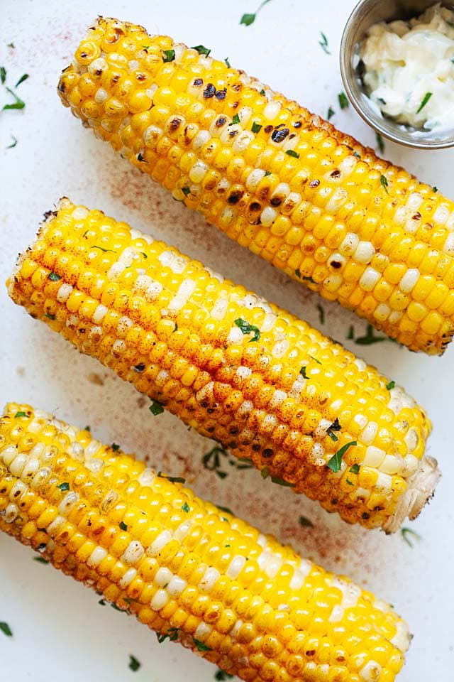 Quick grilled corn with garlic butter seasoning.