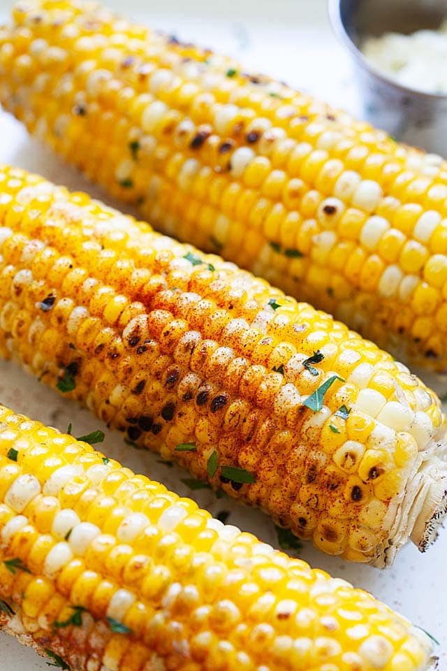 Grilled corn on the cob, ready to serve.