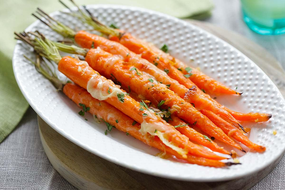 Garlic parmesan carrots on a plate.