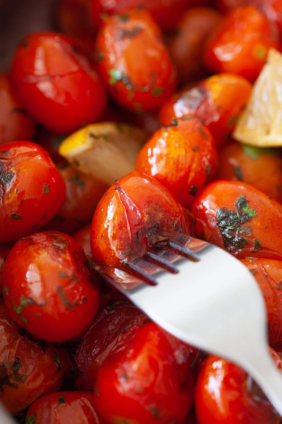 Grilled tomatoes in a skillet.