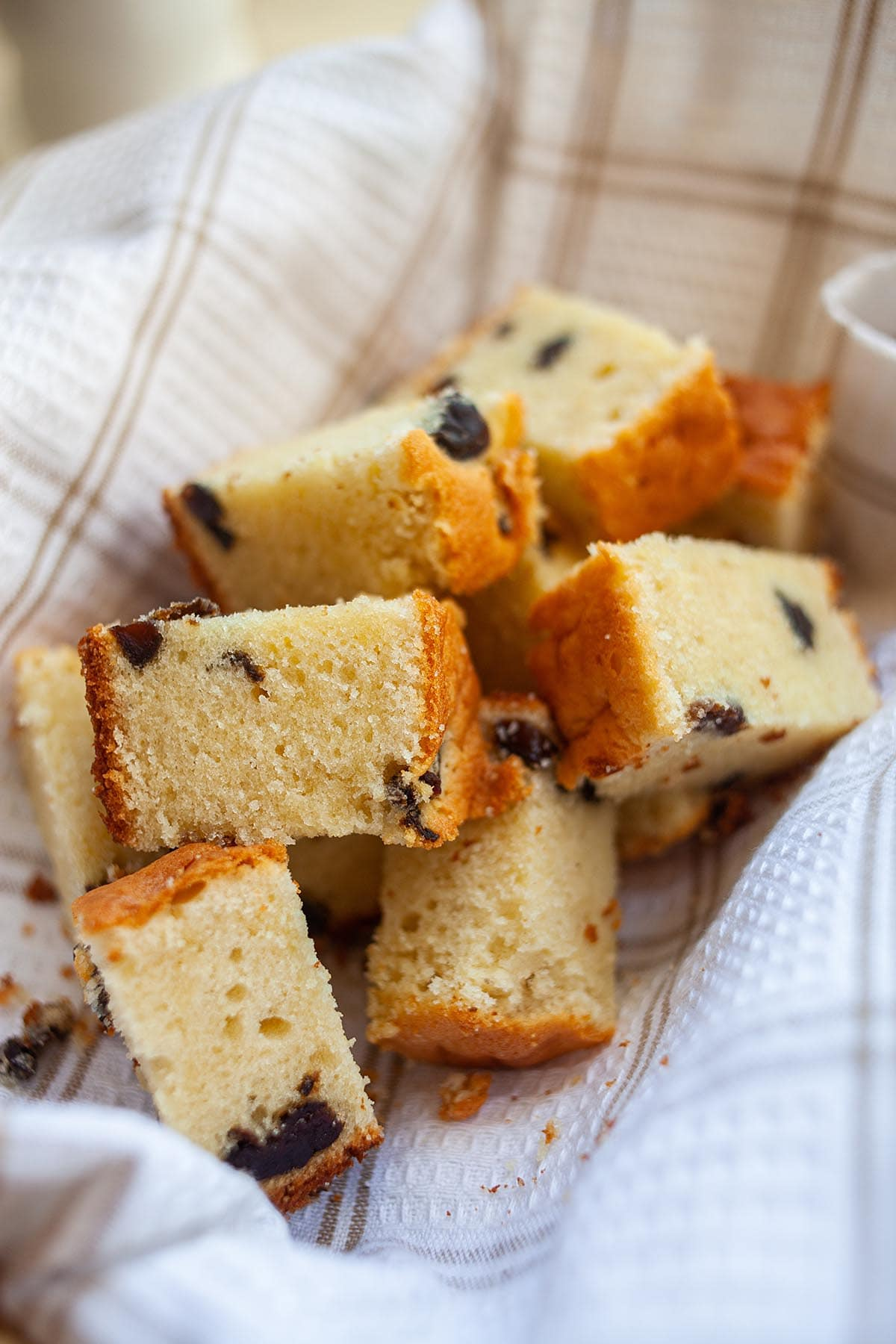 Easy and delicious brandy butter cake made with prunes, served in a basket.
