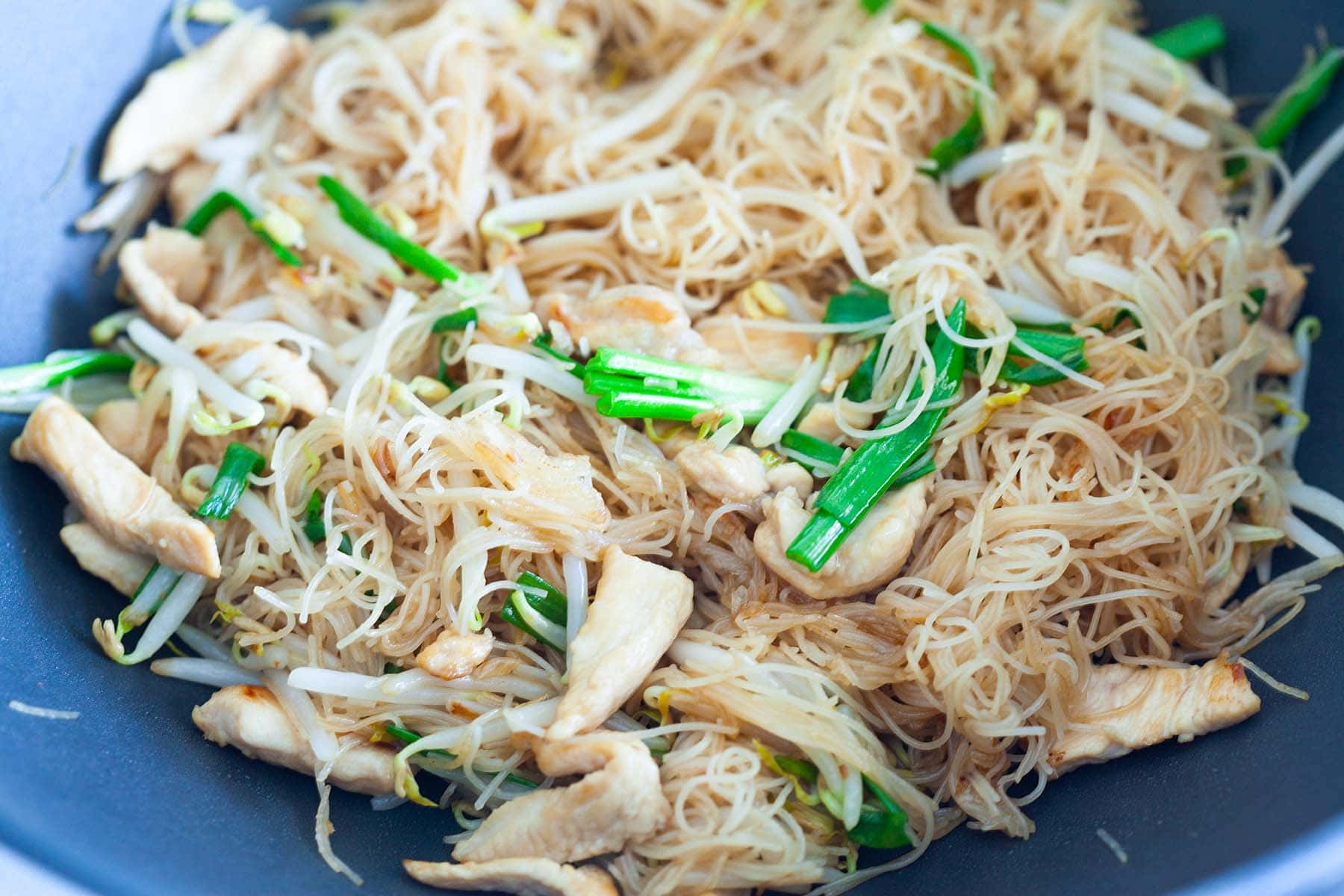 Rice vermicelli, stir-fried in a skillet.