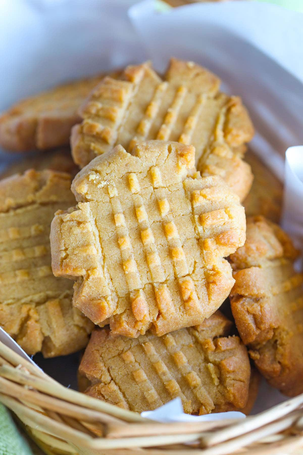 Peanut butter cookies in a baking tray.