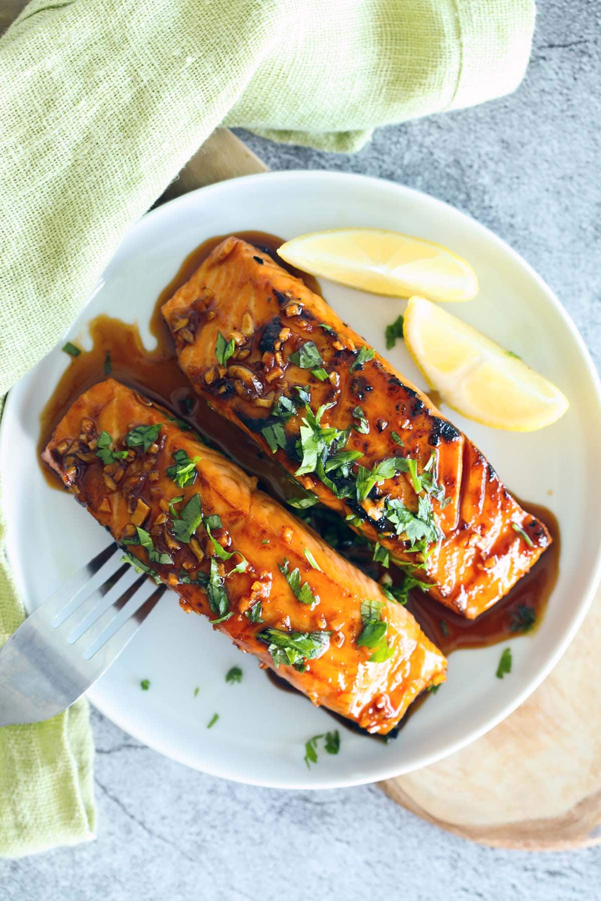 Honey sriracha salmon served on a plate.