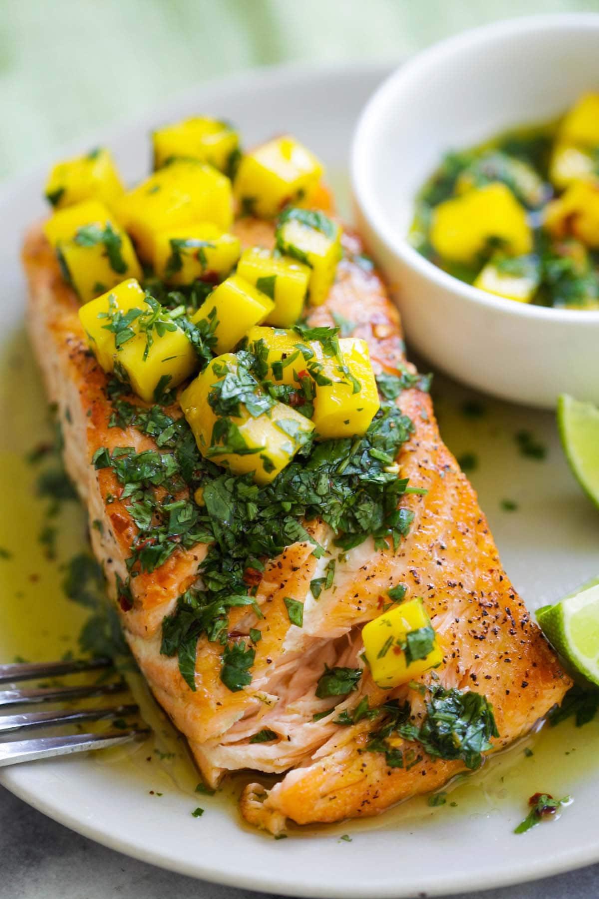 Easy Chimichurri salmon with mango, cilantro, parsley, garlic and olive oil.