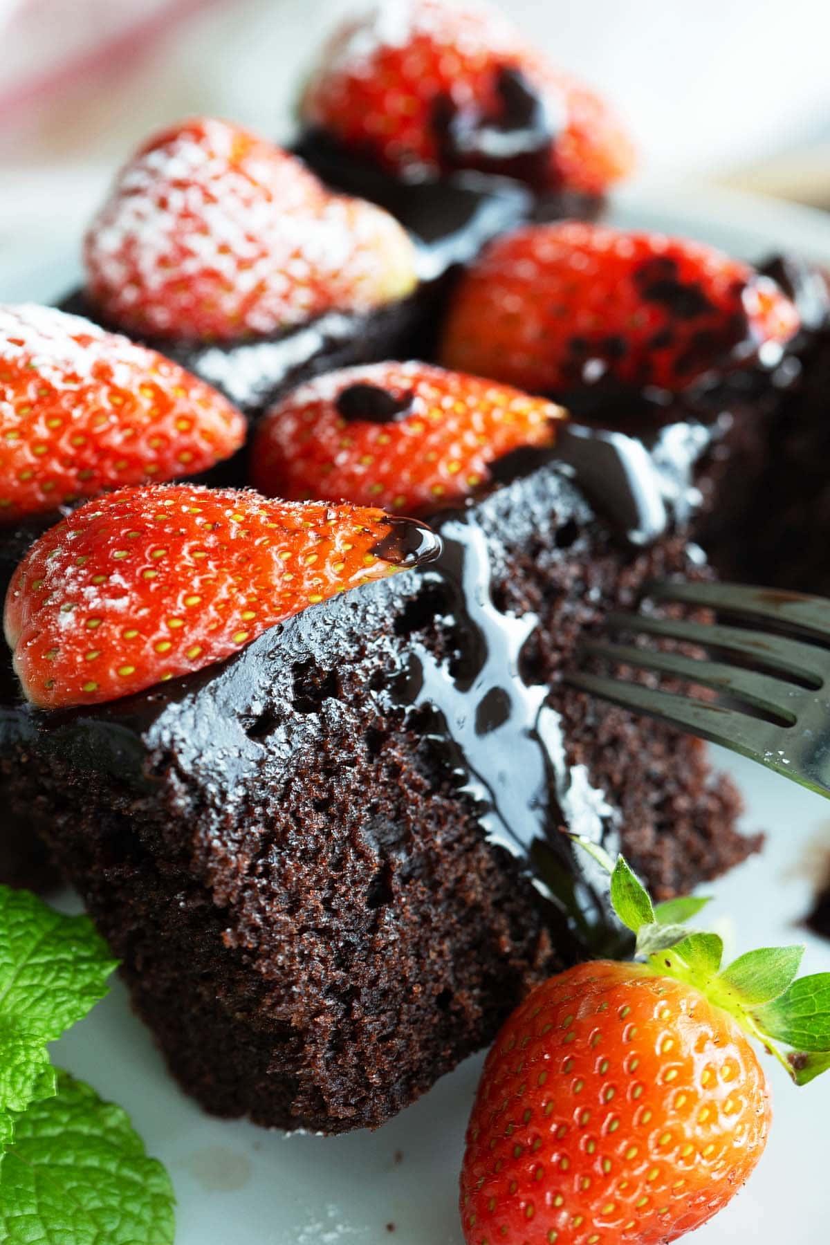Moist chocolate cake on a plate.