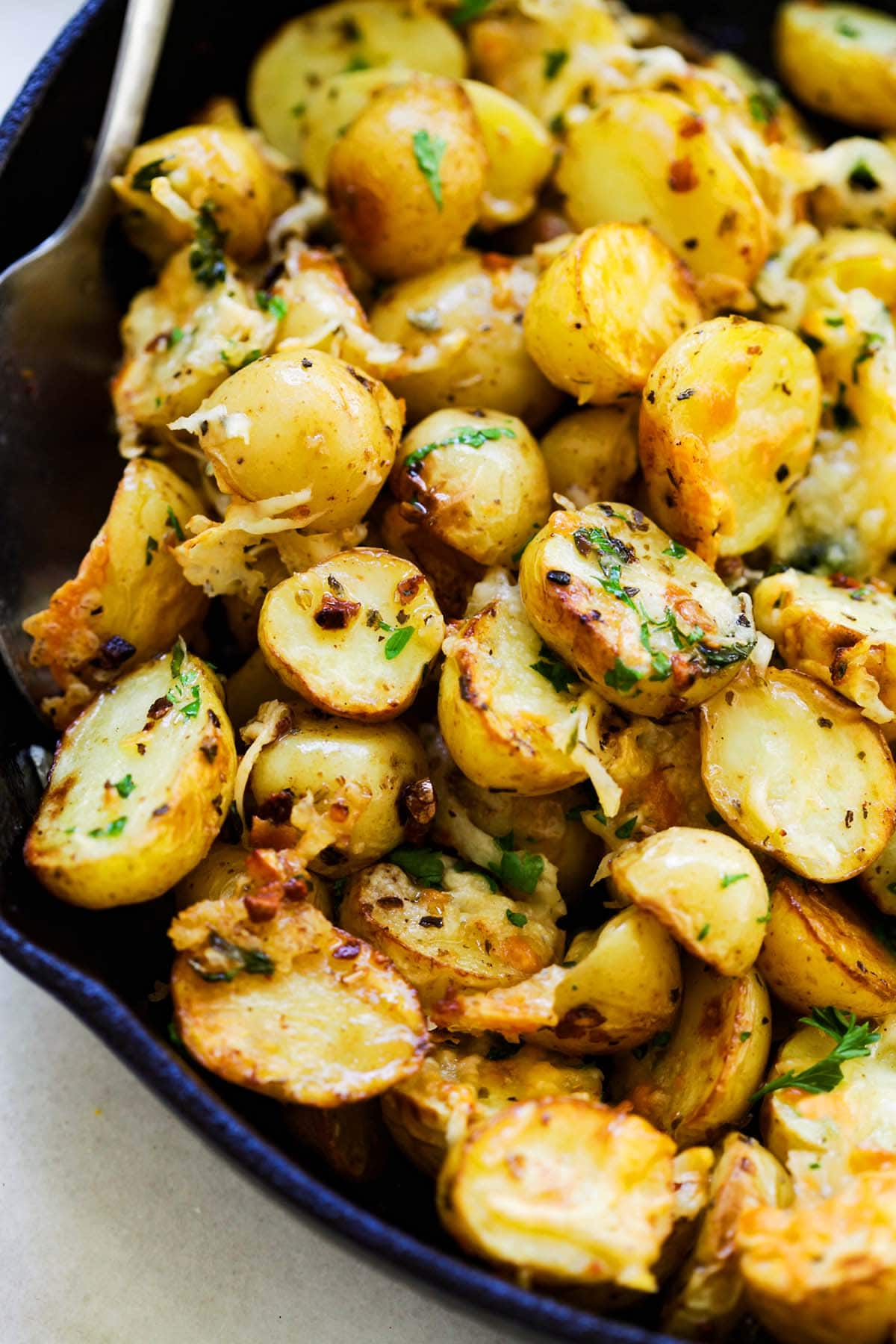 Easy tasty Italian roasted potatoes in a skillet.