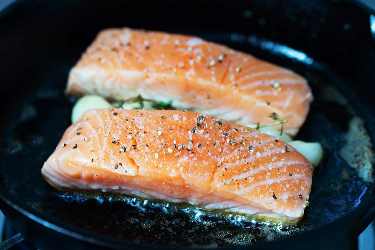 Pan seared salmon in a cast-icon skillet.