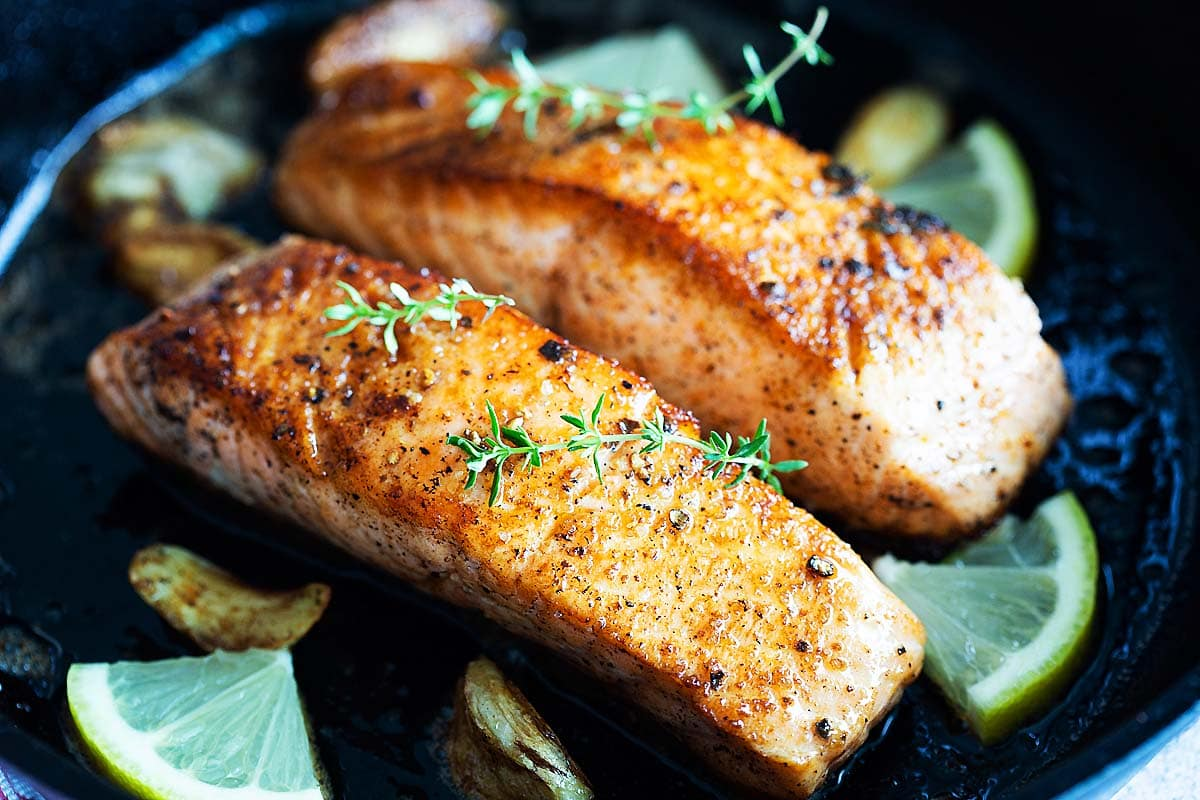 Pan seared salmon fillets with skin.