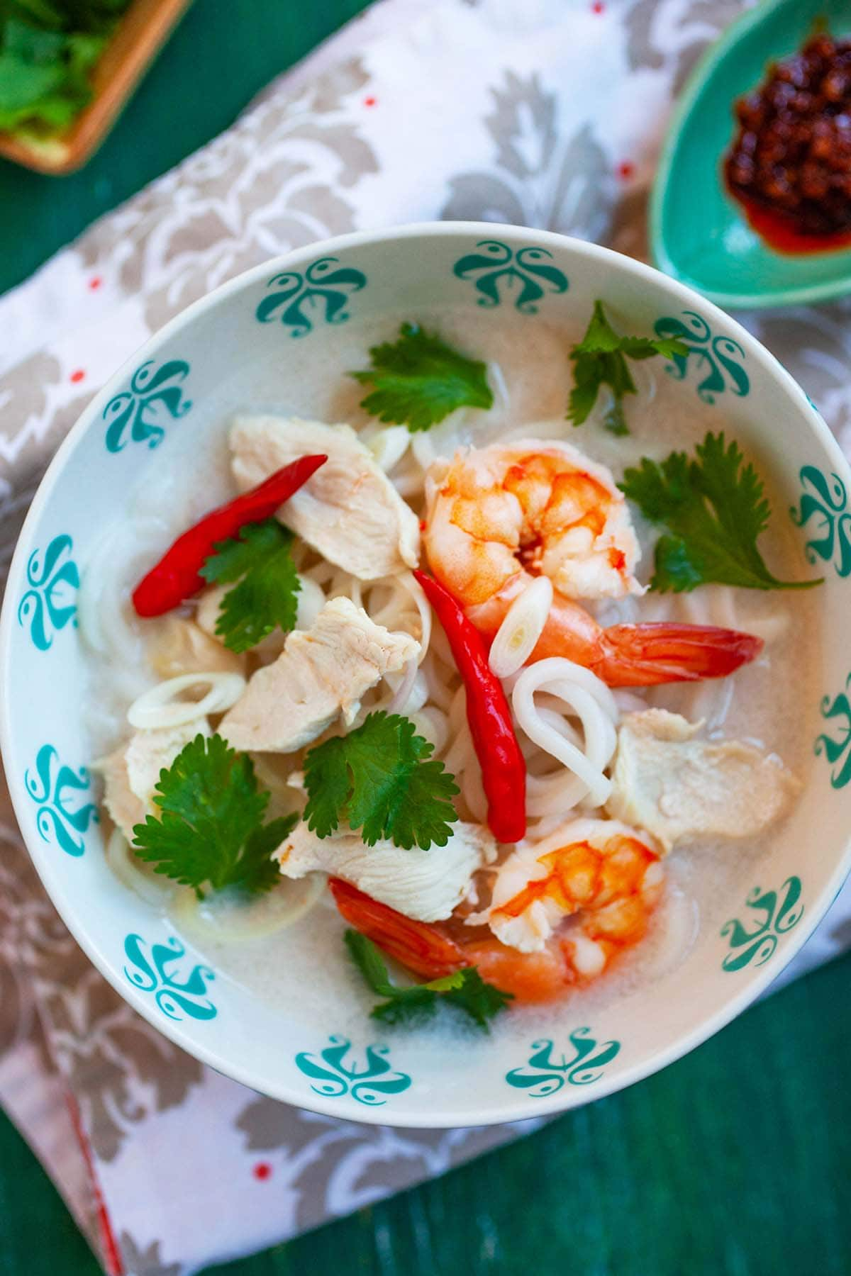 Easy and quick homemade Thai coconut lime chicken soup with noodles served in a bowl.