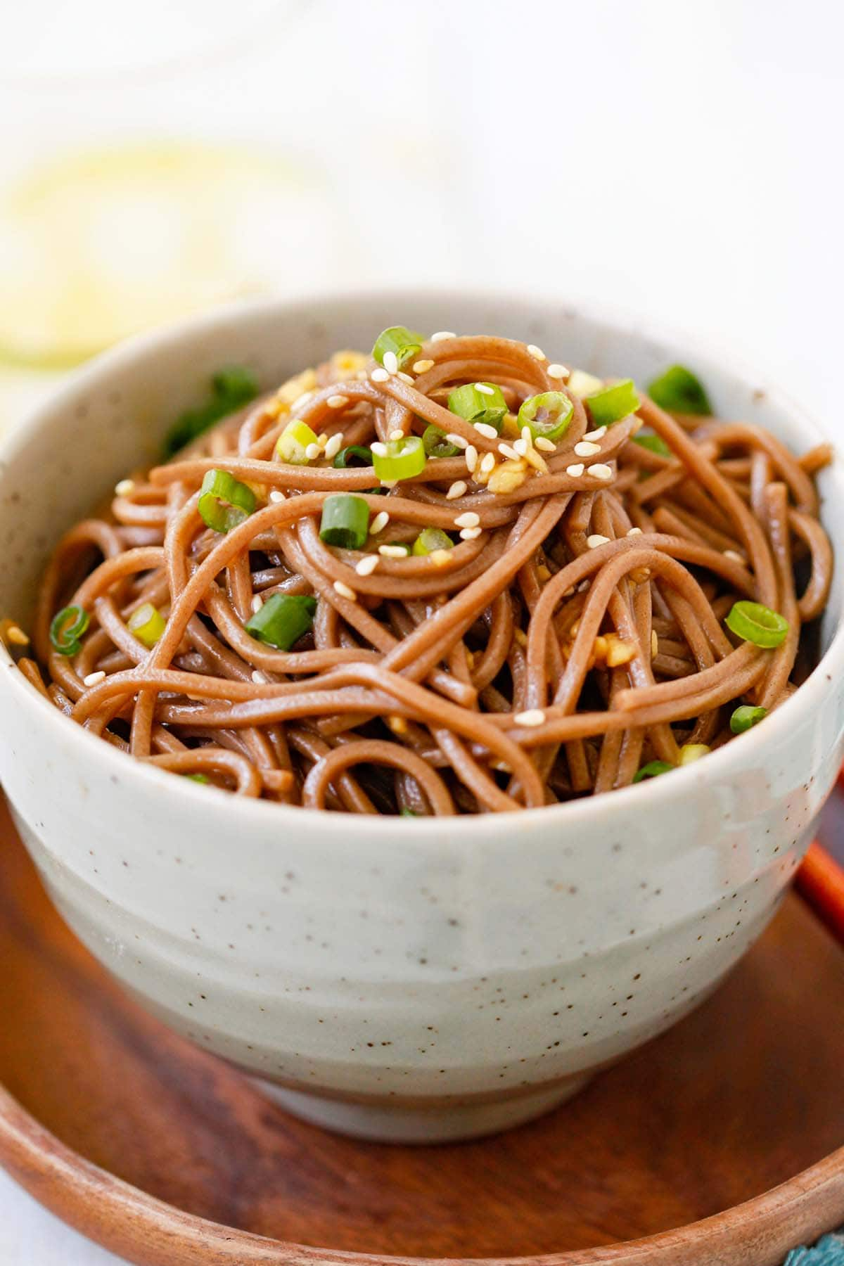 Homemade easy noodles made with ginger, soy sauce, honey and Japanese soba noodles ready to serve.