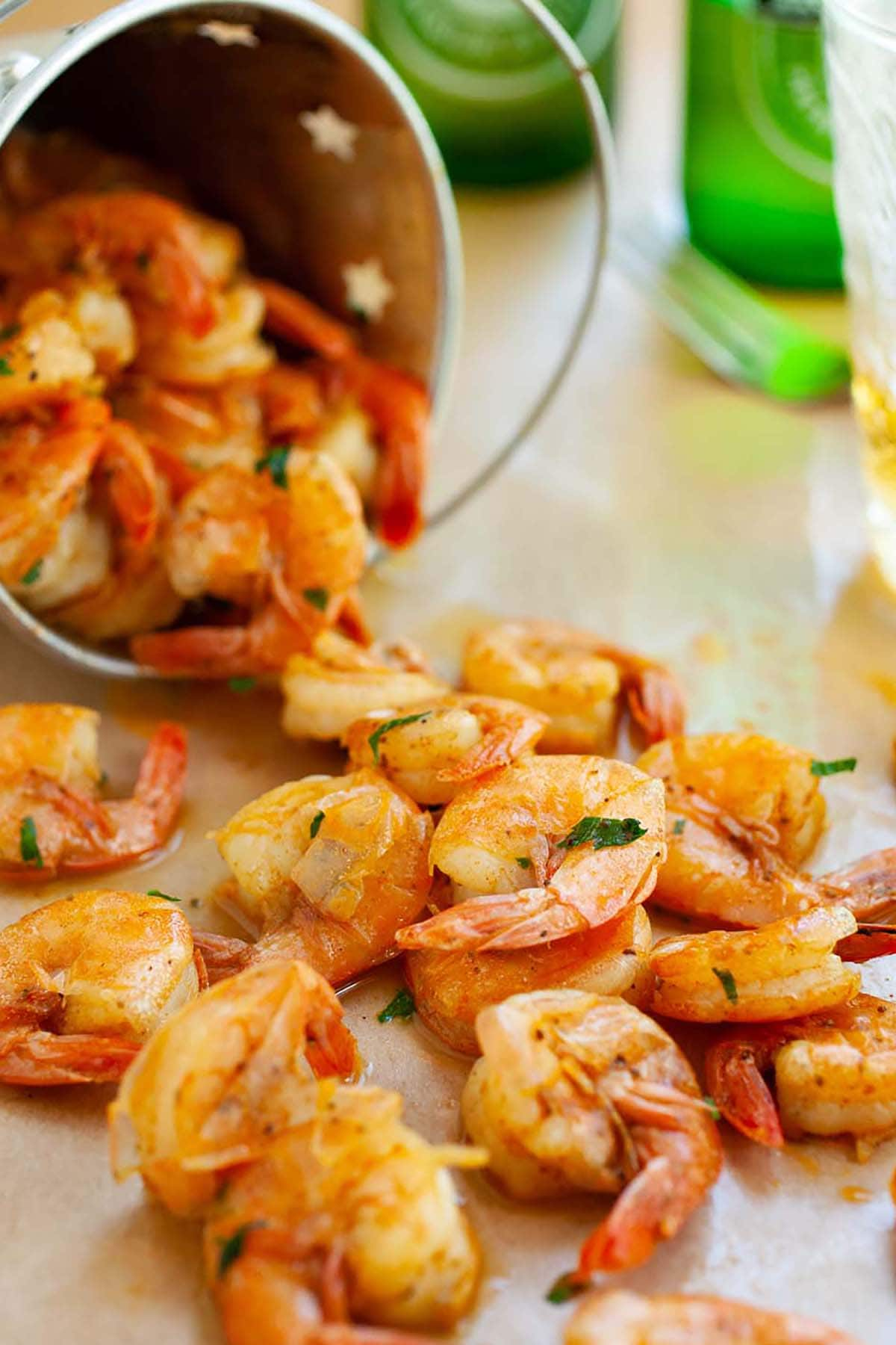 Easy and quick peel and eat shrimps sauteed with butter, beer and spices.