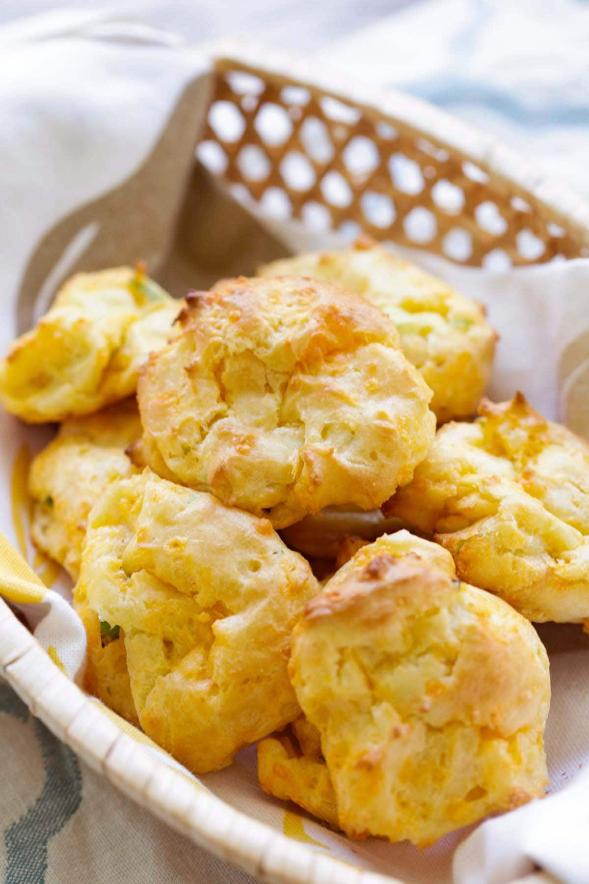 Easy homemade French Cheddar Cheese Puffs served in a basket.