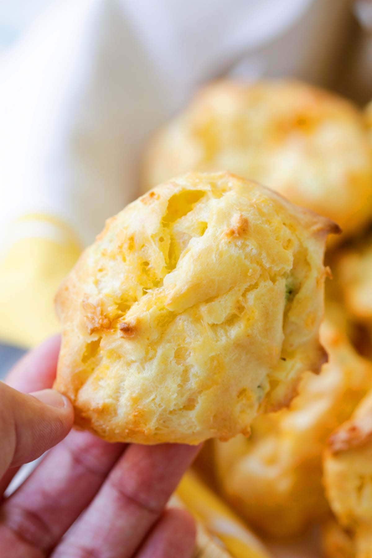 French cheddar cheese puff pastry held in hand.