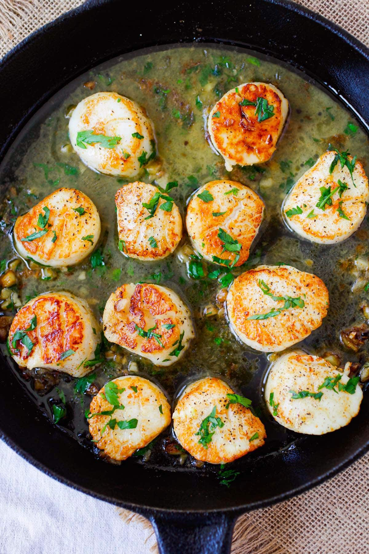 Sauteed scallops with garlic, butter, white wine and parsley.