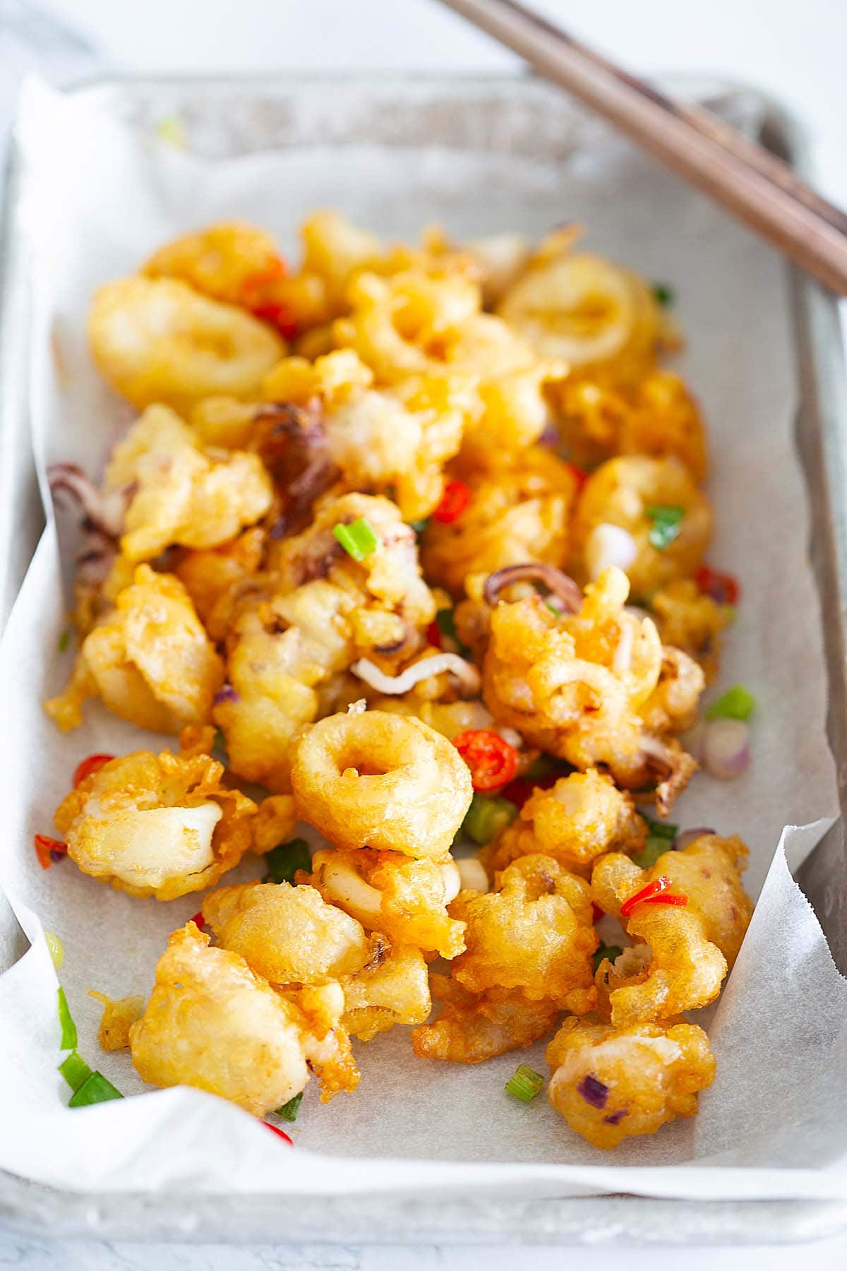 Salt and pepper squid recipe with squid, salt, pepper, scallion and red chilies.