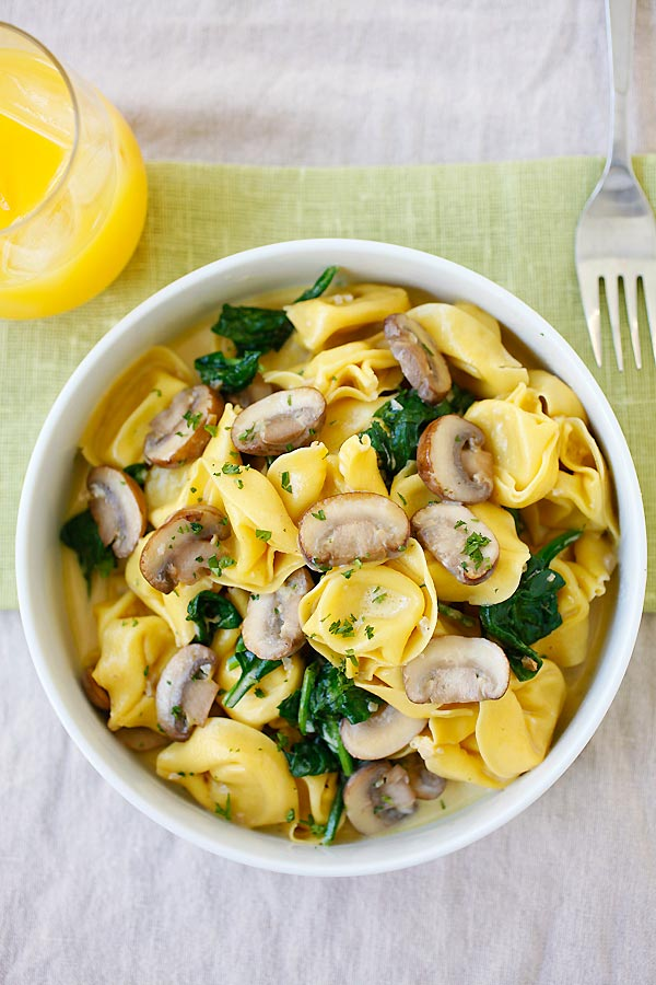 Creamy Mushroom Tortellini with rich buttery mushroom sauce in a bowl.