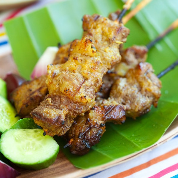 Beef Satay - beef is marinated overnight with spices, skewed to satay and grilled. Best beef satay recipe with spicy peanut sauce | rasamalaysia.com