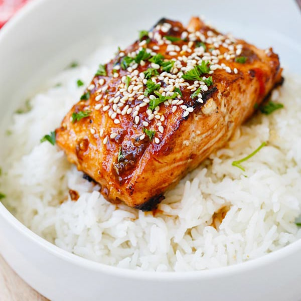 Sweet & Spicy Sriracha-glazed Salmon in the Skinnytaste cookbook. Moist, juicy, and so yummy | rasamalaysia.com