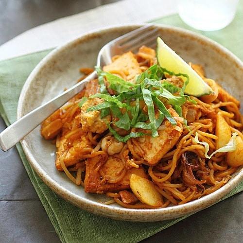 Sour, spicy, sweet, and tangy come through in this Indian mee goreng recipe. I love the fried bean curd, potato, and squid. It is really delicious. | rasamalaysia.com