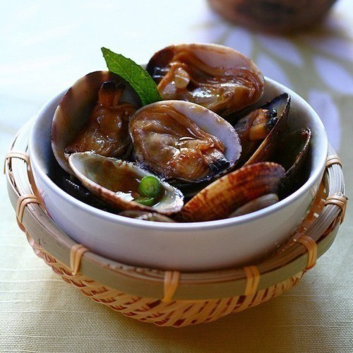 "Kam Heong Clams (Golden Fragrant Clams) – ""Kam Heong"" is a signature Malaysian stir-fry style that is renowned for the fragrance imparted 