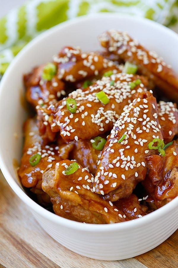 Slow Cooker Honey Sesame Chicken Wings in a sticky savory honey sesame sauce in serving dish.