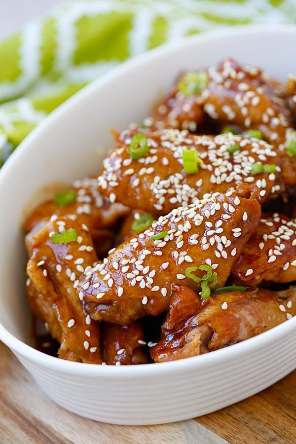 Easy and quick chicken wings in a sticky savory honey sesame sauce garnished with sesame seeds.
