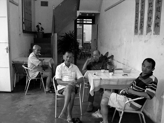 A few old men in a Kopi Tiam (Coffee Shop). Guess which one is my father?