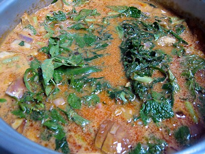 Perut Ikan / Nyonya Fermented Fish Stomach Curry - Add in coconut milk and all the aromatic leaves