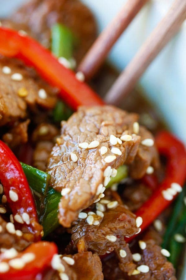 Beef stir-fry in Asian soy brown sauce garnished with sesame seeds.