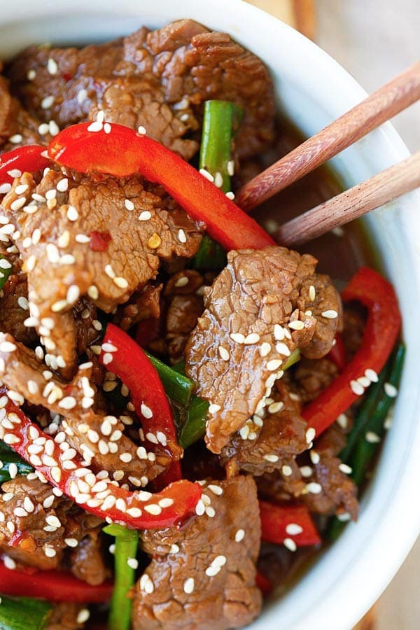 Asian stir-fry sesame beef homemade brown sauce close up.