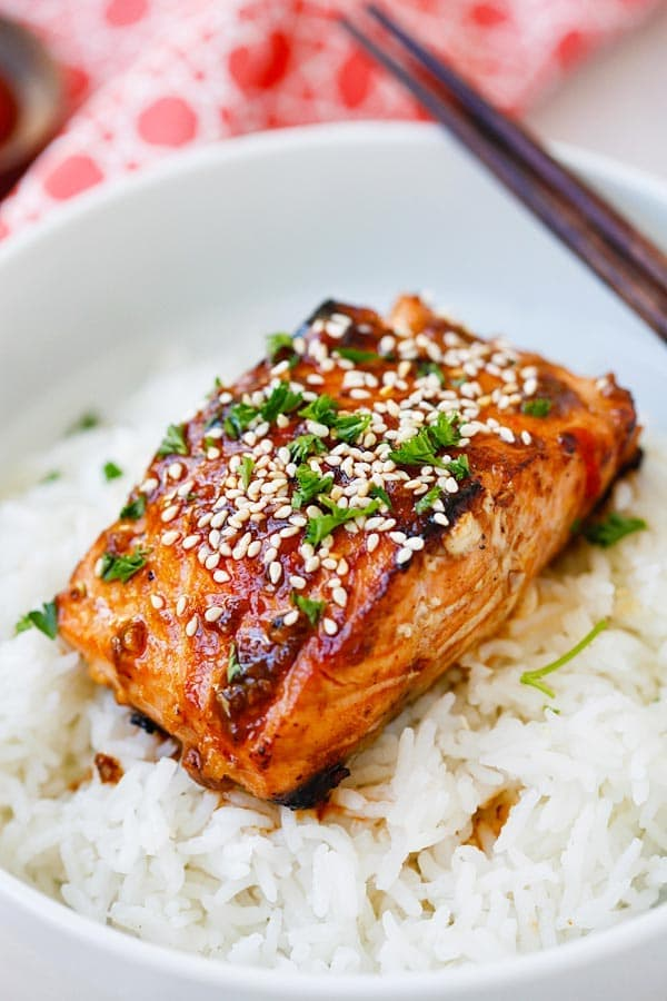 Honey Sriracha Salmon with honey glazed sauce on top of rice.