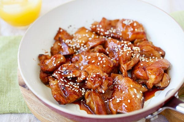 Teriyaki chicken thighs in teriyaki sauce, served on a plate.